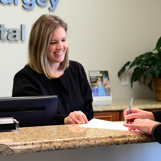 Patient turning in dental insurance forms